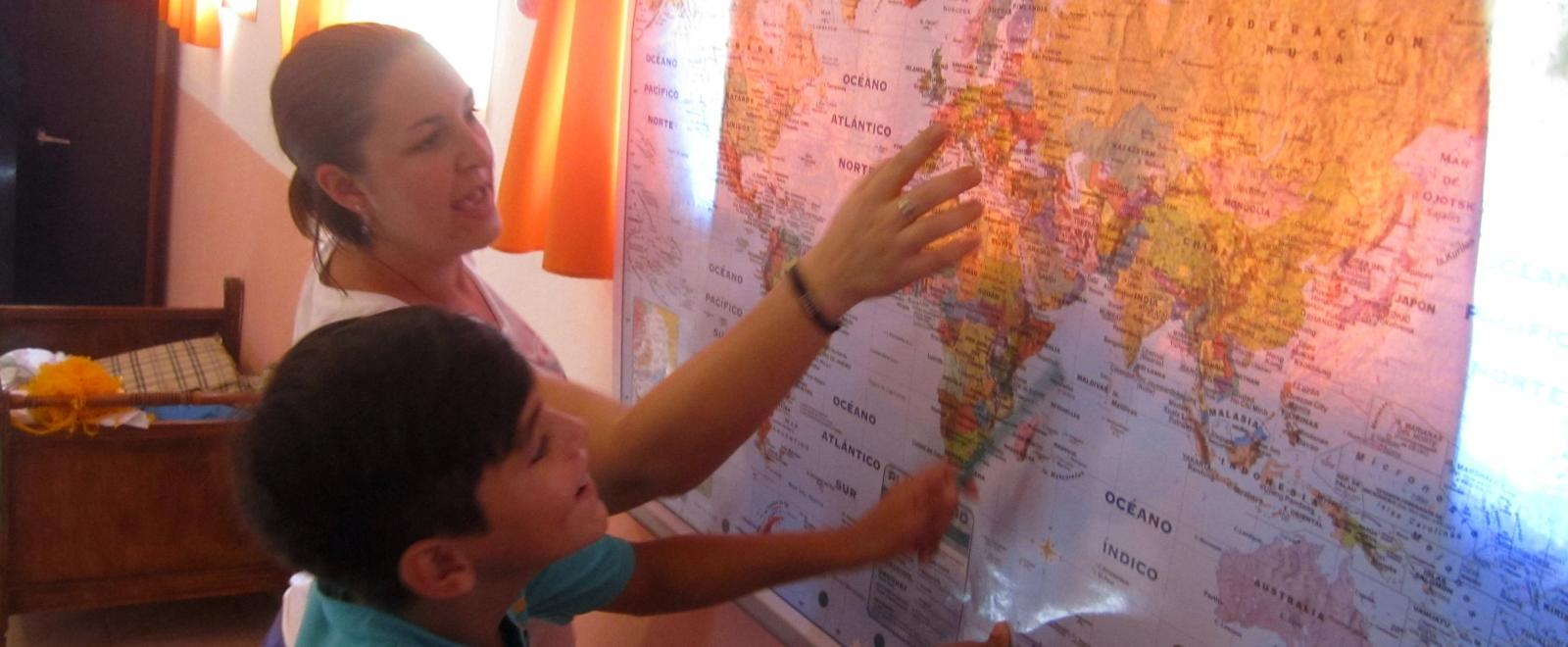 A volunteer teaches geography as part of her volunteer teaching project in Argentina.
